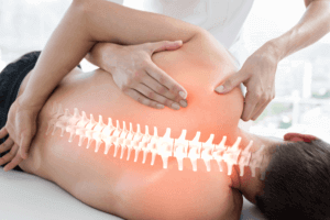 therapist doing theraoy on his patient back