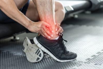 Asian man injury ankle pain